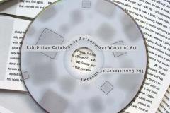a0187afbd7ef7b18-closeupofCDROMandbooklet6x9